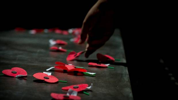 A poppy being placed on the Tomb of the Unknown Warrior in Wellington
