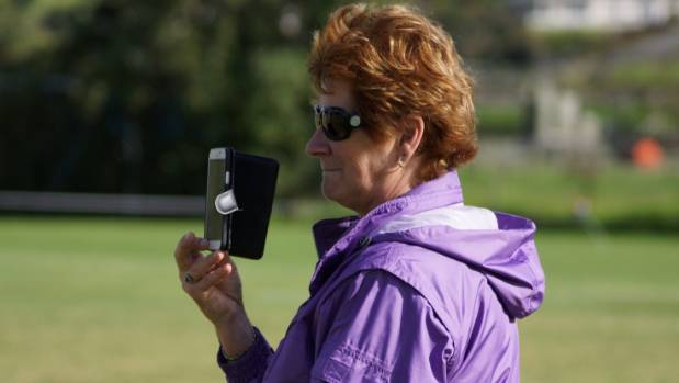 Mary Montgomery holds up her phone so that son Evan can watch Northern Wairoa play their first Chatham Cup game from the ...