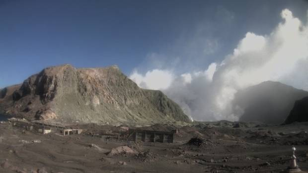 The White Island webcam shows ash from the explosion, which has settled on the crater floor.