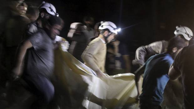 Civil defence members carry a casualty after an airstrike at a field hospital in the al-Sukari district of Aleppo, Syria.