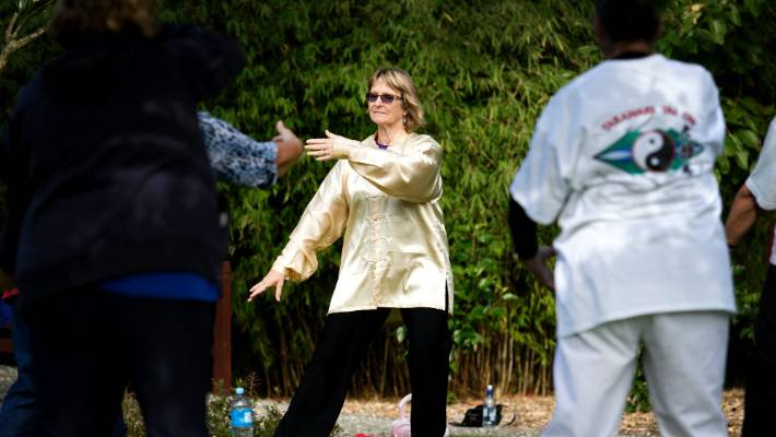 Taranaki Tai Chi principal instructor Judi Lee runs a tai chi day class at the Kumming Gardens in Brooklands Park.