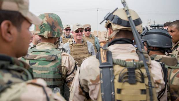 Prime Minister John Key pictured with Kiwi troops based at Camp Taji in Iraq. Labour MP Phil Goff says current soldiers ...