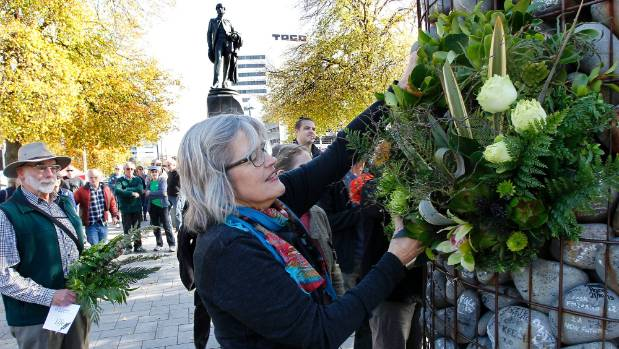 Green Party Christchurch spokeswoman Eugenie Sage lays a wreath on a cairn in Cathedral Square on Saturday to mark six ...