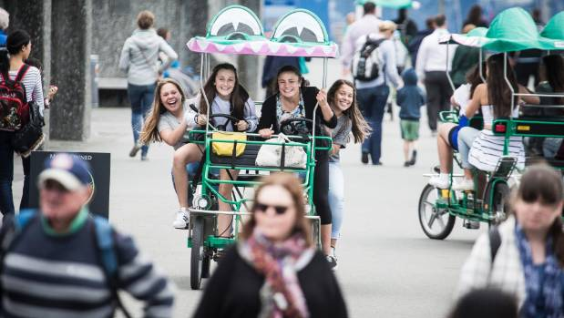 Alison Johnson, Katie Hoffman, Lara Cooper, and Kayla Tofilau enjoy a crocodile bike ride on the waterfront.