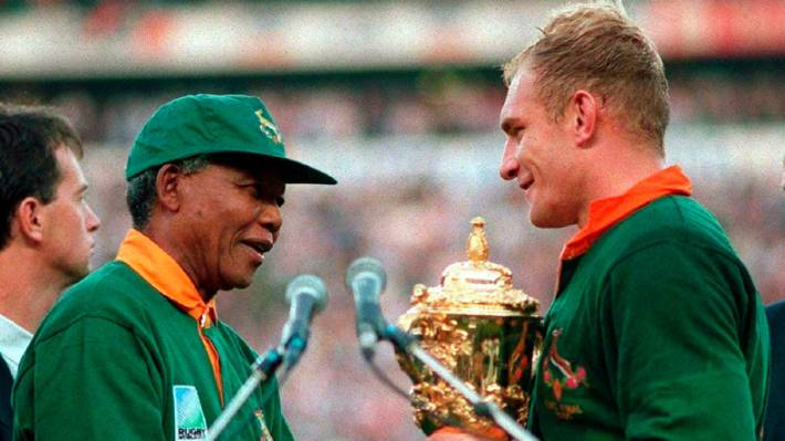 a0ee72946fe Then-South Africa President Nelson Mandela presents the William Webb Ellis  Cup to Springboks captain