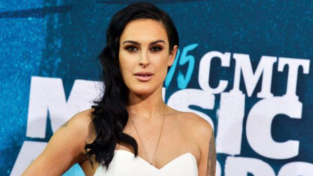 Rumer Willis says she grew up feeling self-conscious about her looks.
