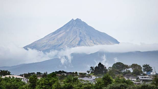 An academic says the playmate's nude photo on Mt Taranaki disrespects the mountain.