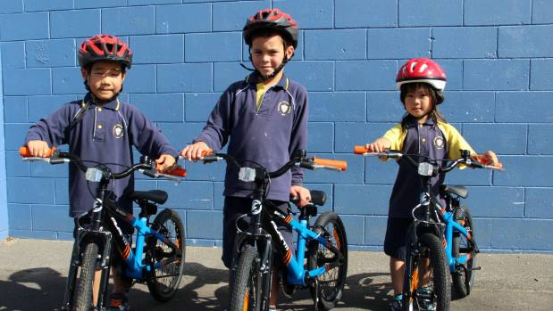 Takapuna Primary School students Siha Choi, left, Jayziah Gerrand, and Uri Lee, all 5, are excited to learn how to ride ...