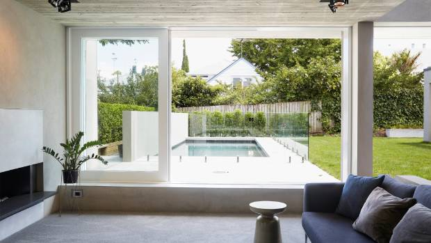 This sunken lounge in a new extension to a traditional villa, by architect Gerrad Hall, epitomises the move towards more ...