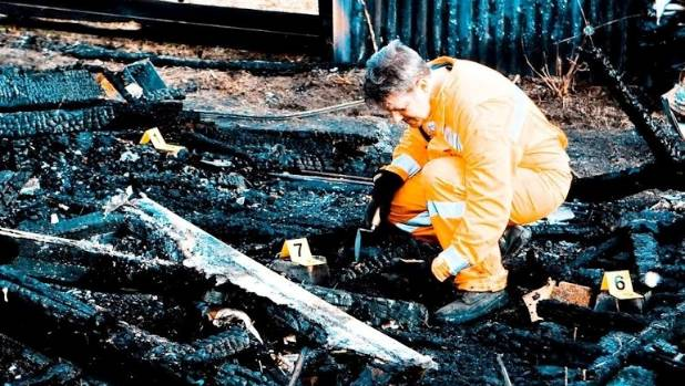 Neil MacKay working on the remains of a fire.