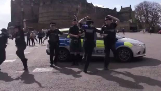 Police in Scotland giving a Scottish twist to the Running Man challenge.