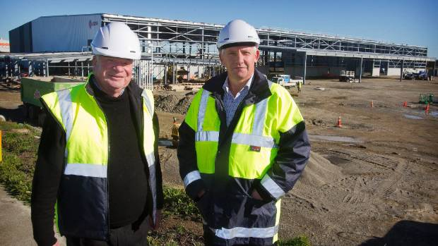 Property developer Brian Green, left, with DKSH director Russell Wilson at the construction of DKSH's HQ last year, has ...
