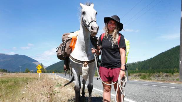 Marie Palzer of Marahau hoofing around for a change with Spirit on her way to St Arnaud and heading all the way to ...