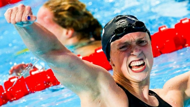US swimming machine Katie Ledecky celebrates after setting a world record in the women's 800m freestyle final at the ...
