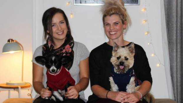 Rebecca Foley, left, and Catherine Ashurst also offer puppy cuddles with their new post-party cleaning service.