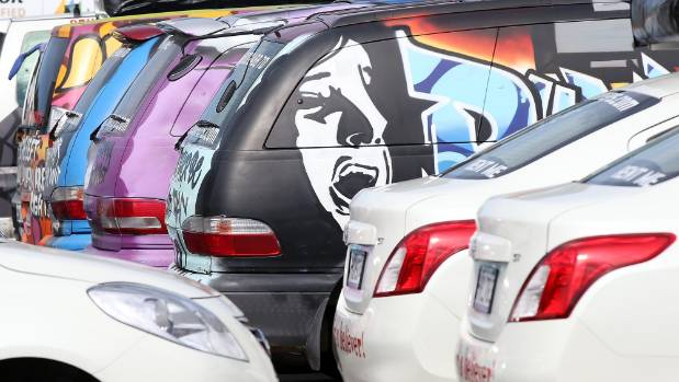 Vans at Wicked Campers depot in Penrose, Auckland.