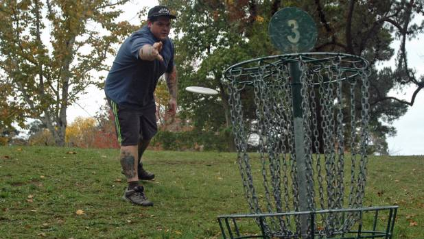 Jackson Sullivan is right at home with disc golf at Upper Hutt's Harcourt Park. Photo: COLIN WILLIAMS