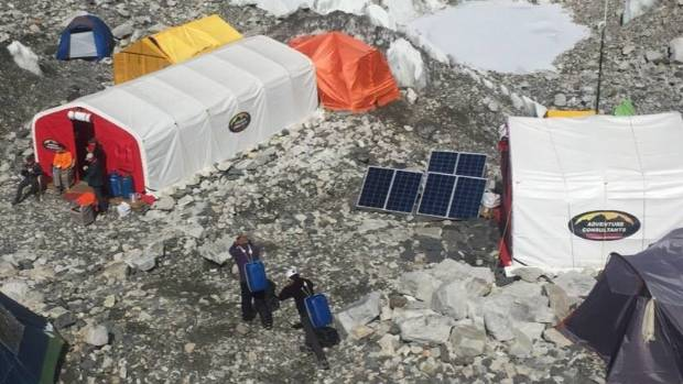 Sherpas carrying water at base camp.
