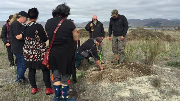 Rangitane iwi members repatriate remains of early New Zealand settlers at Wairau Bar in April 2016.