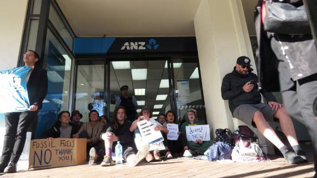 Protesters block the entrance to three branches of the ANZ in Dunedin.