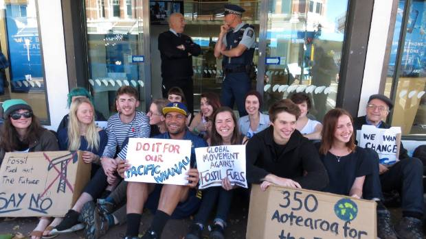 Protesters, including Highlanders' winger Patrick Osborne, block the entrance to three branches of the ANZ in Dunedin.