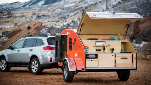 The trunk opens up to reveal a fully equipped mini kitchen.