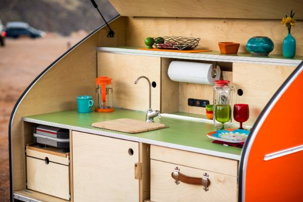 The trailer comes with its own mini kitchen, complete with sink, tap and paper towel rack.