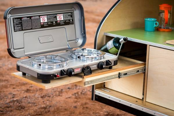Another drawer slide accommodates a mini cooktop.