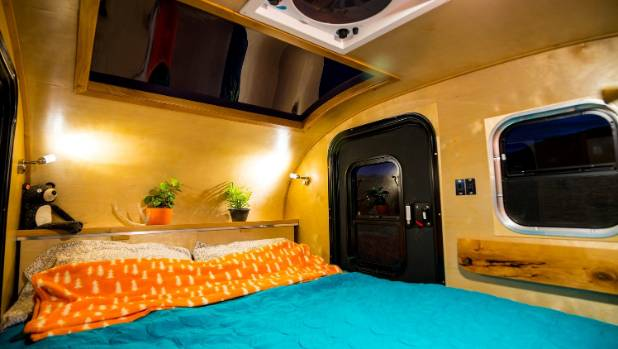 The bed is positioned beneath a large skylight - so you can see the stars as you nod off.
