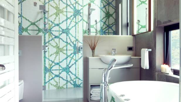 A floor to ceiling graphic tile mosaic is a powerful statement piece that adds the 'wow' factor.
