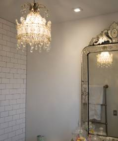 Nothing says glamorous quite like a sparkly chandelier and opulent vanity.
