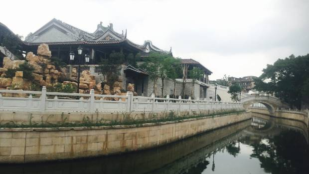 The newly constructed Opera Museum alongside one of the canals in Guangzhou.