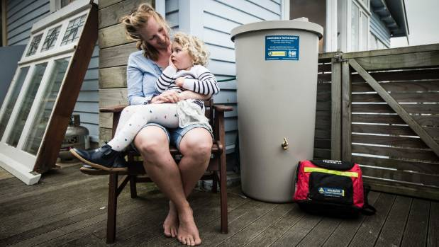 "Eva Neely with her daughter Mara, 3. The family has a 200-litre rainwater tank and ""Grab and Go"" bag for emergencies."