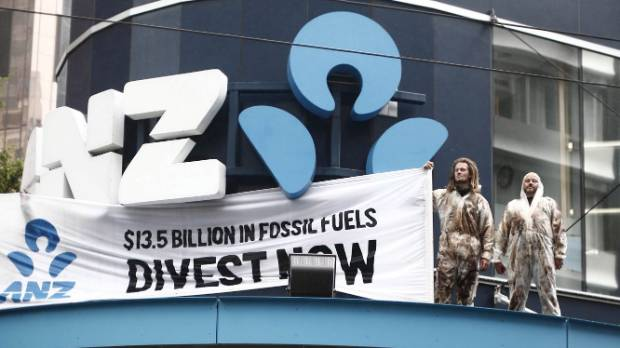 Protesters climb onto a Lambton Quay ANZ branch to voice their opposition to the bank's fossil fuel investments.
