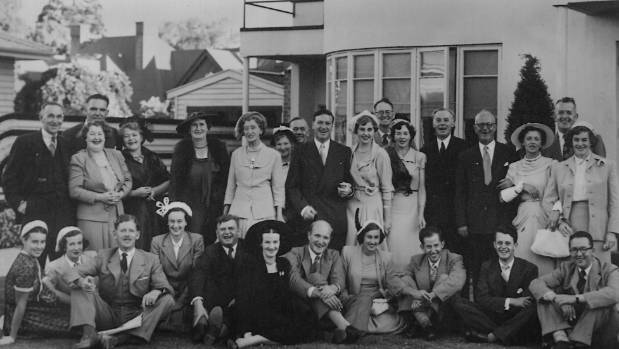 A photo of the Smith's wedding party, celebrating in front of their Riccarton home.