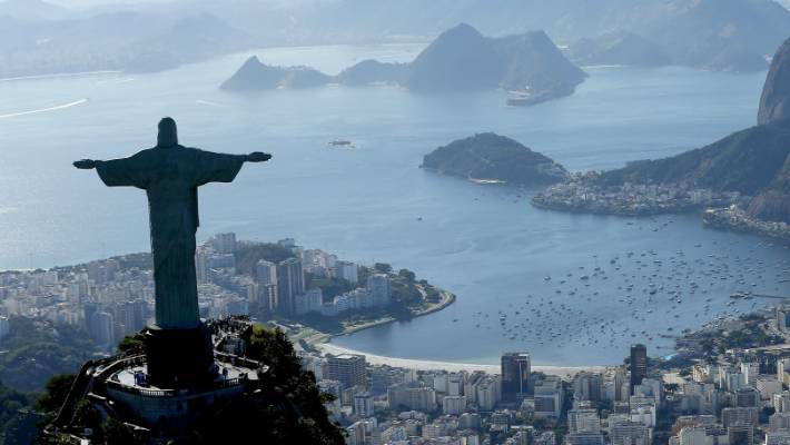 Robbers stole cellphones, cameras, wedding rings and credit cards from tourists near Rio's Christ the Redeemer statue.