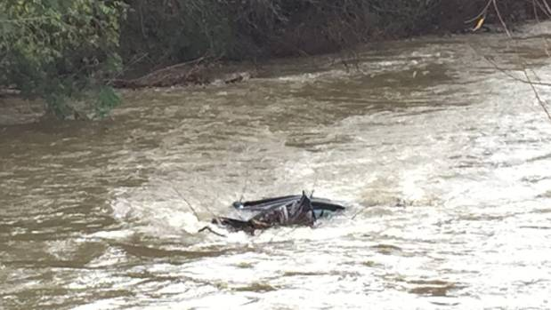A small piece of the submerged car gives an indication of how little space there was for the three people who were ...