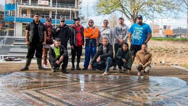 He Toki civil skills students gather around their eye-catching ceramic-encrusted te whariki manaaki (woven mat of ...