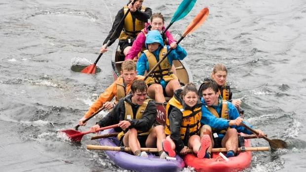 Having to build their own raft the New Plymouth Girls/Boys High School team powers along.