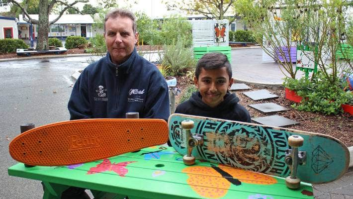 OnBoard Skate chief executive Steve Hodges and Western Heights School student Manav Treekam, 11, a member of the school's skate club.