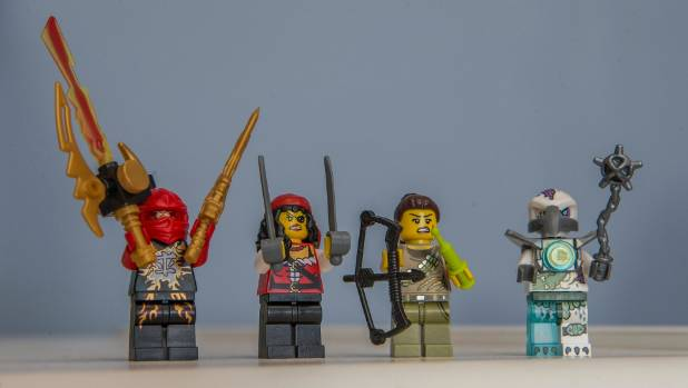 Lego characters with weapons.