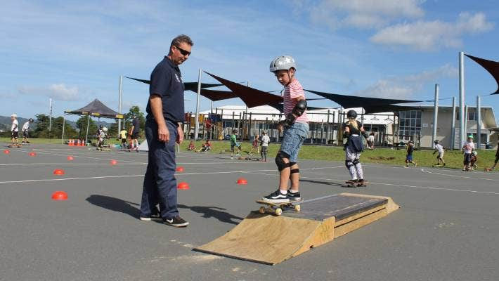Steve Hodges guides a young Western Heights School skater.
