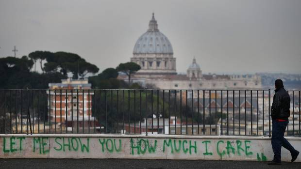Graffiti adorns the walls of Rome, Italy.