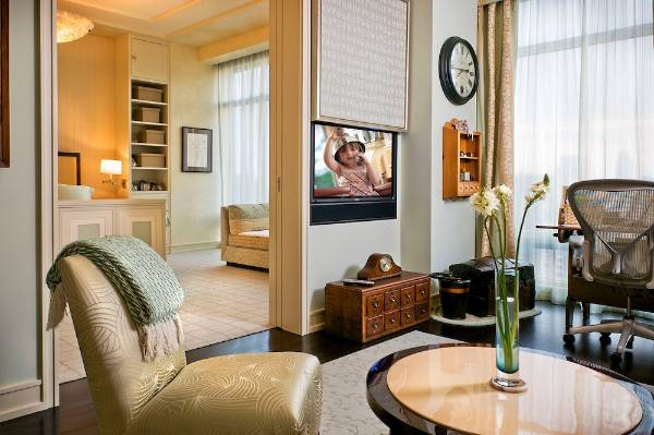 14 clever and stylish ways to disguise the tv for Hide tv in living room