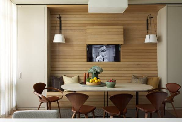 Pop Up Wooden Panelling Cleverly Hides The TV In This Dining Room