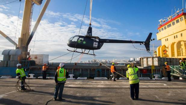 A helicopter which will be used in a programme to eradicate mice from Antipodes Island is loaded onto Norfolk Guardian ...
