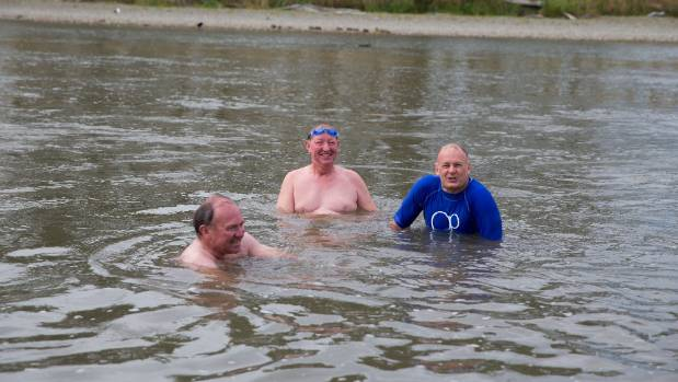 Environment Minister Nick Smith, middle, pictured swimming in the Manawatu River, has announced $100 million for ...