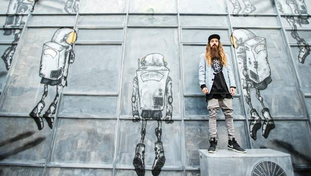The artist known as Milarky, Damin Radford-Scott stands in front of his latest New Plymouth work 'Reforestation', on ...