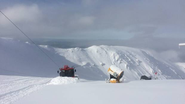 A snow groomer pushes new snow up Fascination trail at Mt Hutt after snow fall over the weekend.