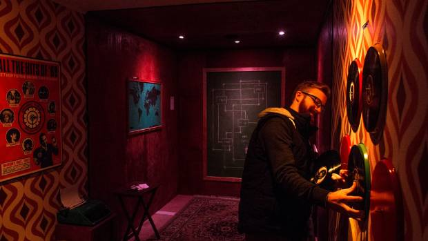 Henry Jones (pictured) tests one of the puzzles he created with Brett O'Donnell for Crate Escape - a game requiring up ...